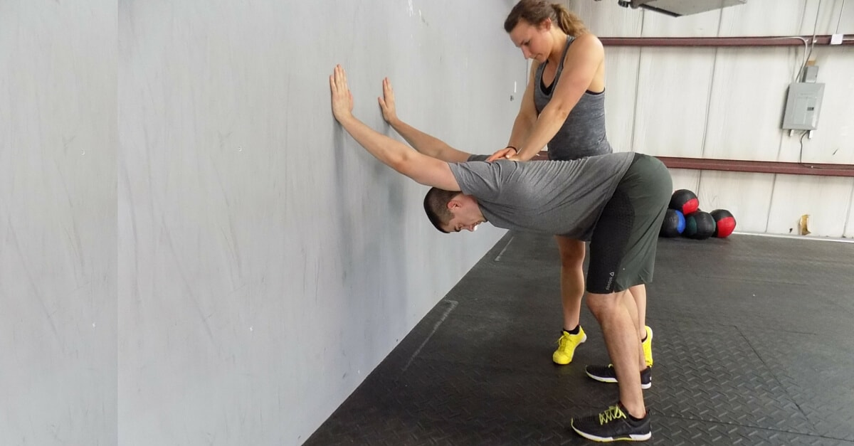 Top Five Thoracic Mobility Drills to Improve Your Overhead Pressing - The  Barbell Physio
